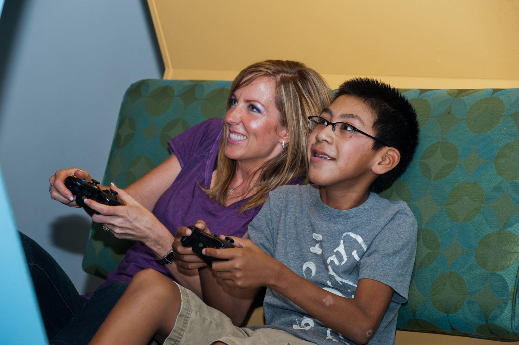 Boy with mom in game room