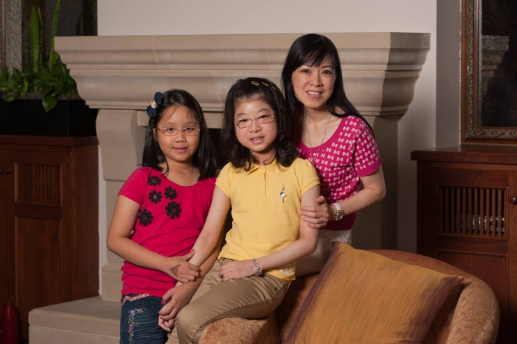 Emma Tran with her mother and sister.