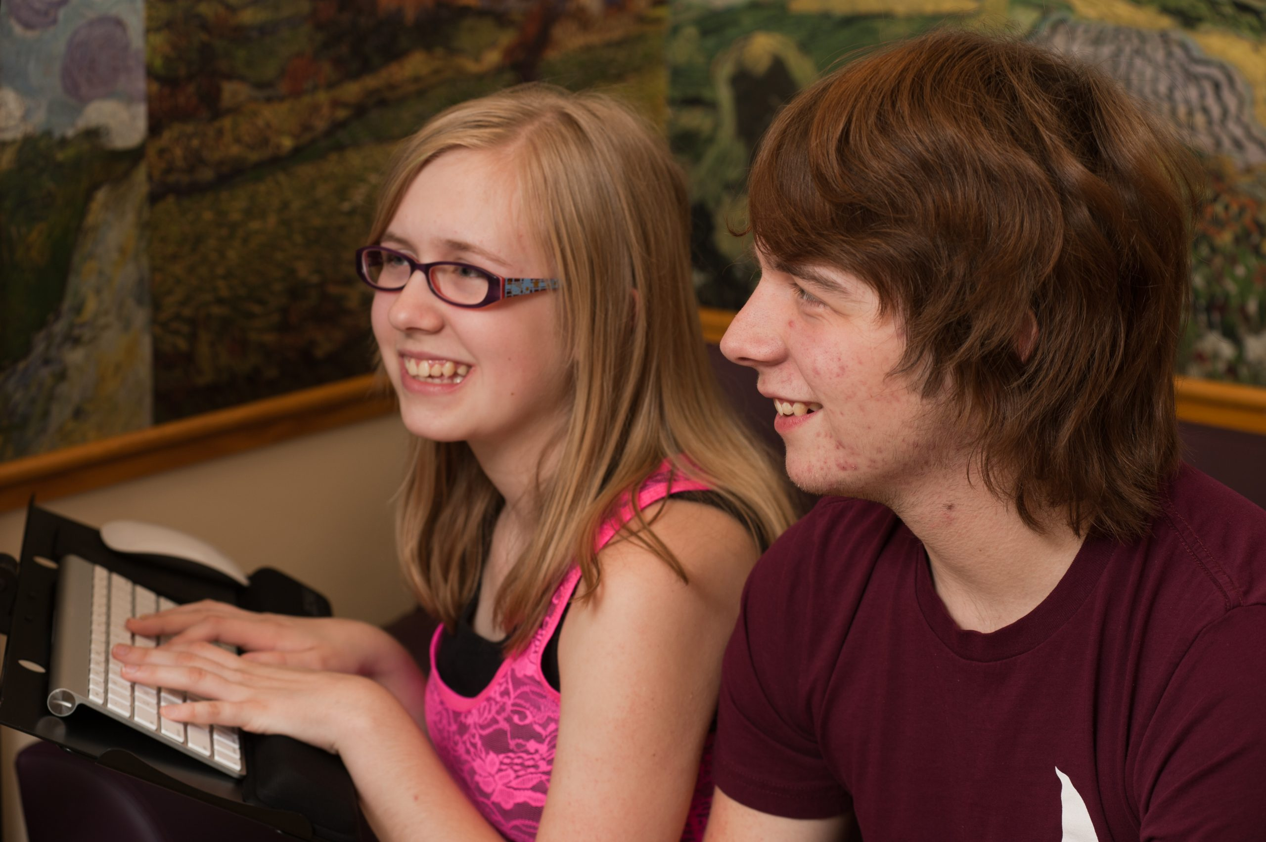 Kayla and Cody, Siblings, on a computer in The Children