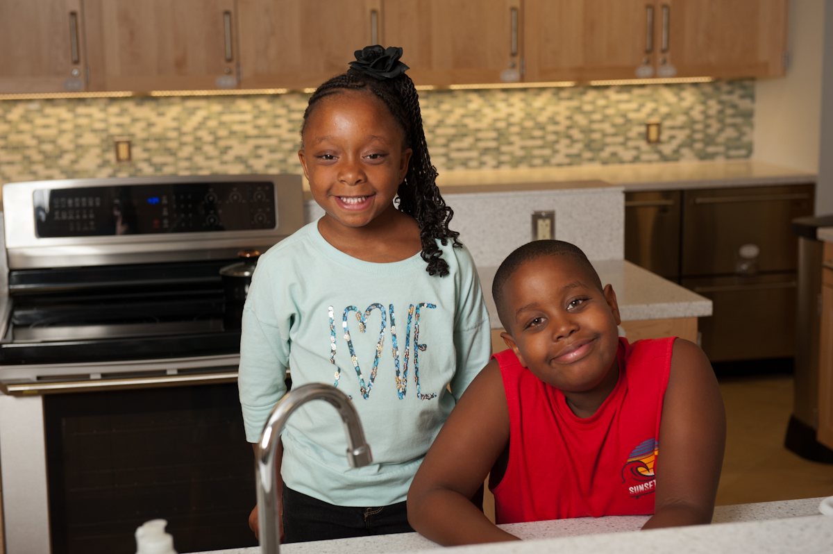 Sydney and her Brother in The Children's Inn's Kitchen