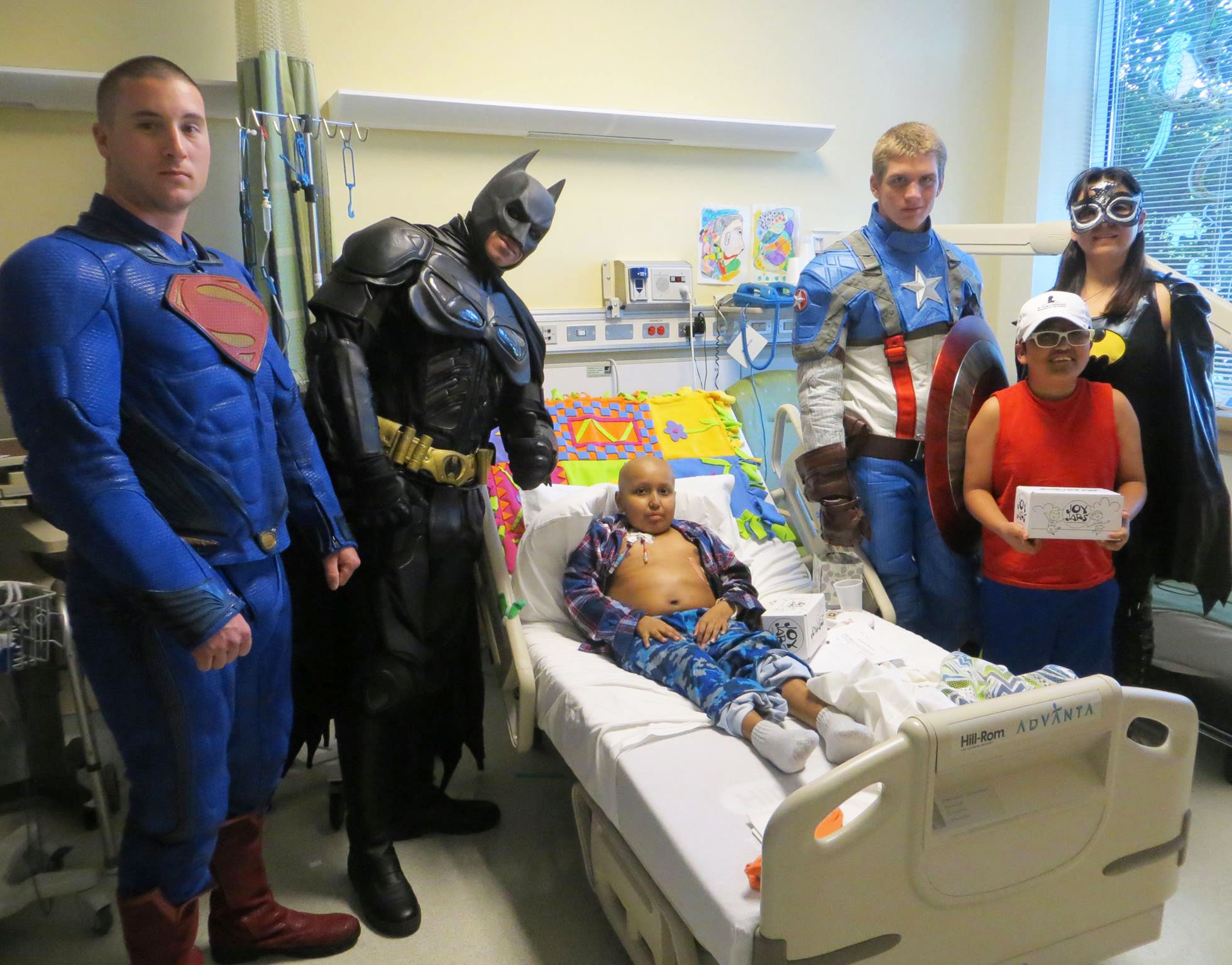 Camp TLC superheros visit sick kids at the NIH Clinical Center