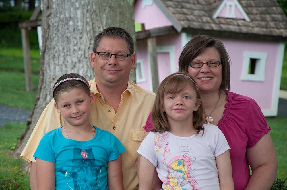 Marijka and family on playground, family of 4