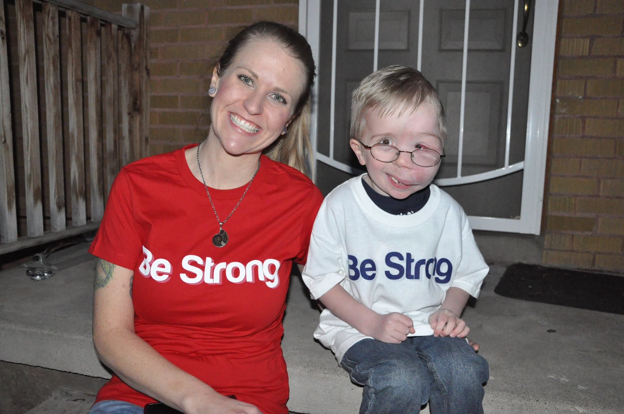 "Ryker and his mom Sarah with t-shirts on that say ""Be Strong."""