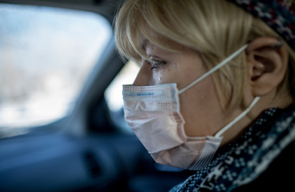 Karly in car with mask and tears