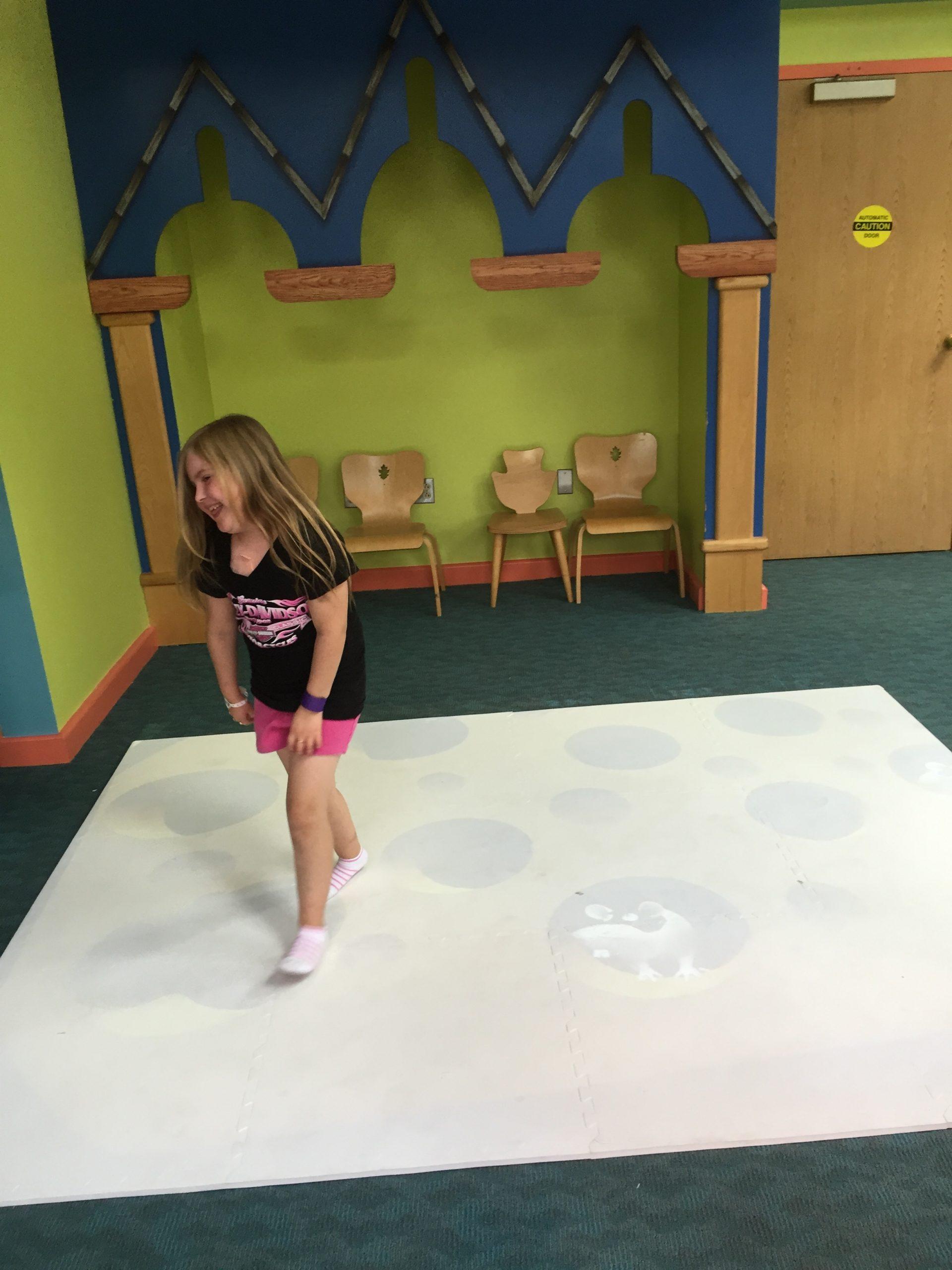 little girl enjoys interactive games