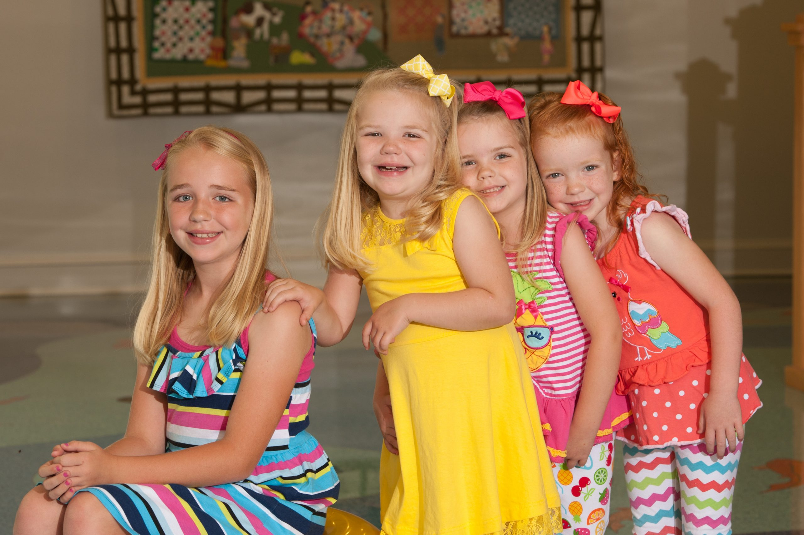Olivia and her three sisters pose for a picture together at the Children