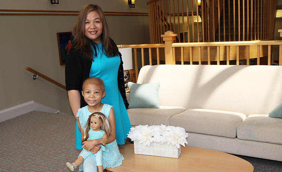 Mother and daughter in teal dresses pose for picture at The Inn