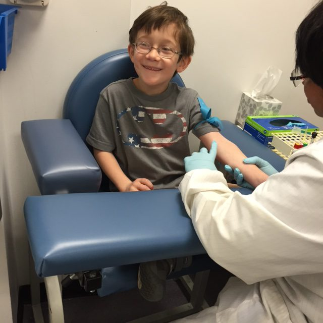 child getting blood drawn