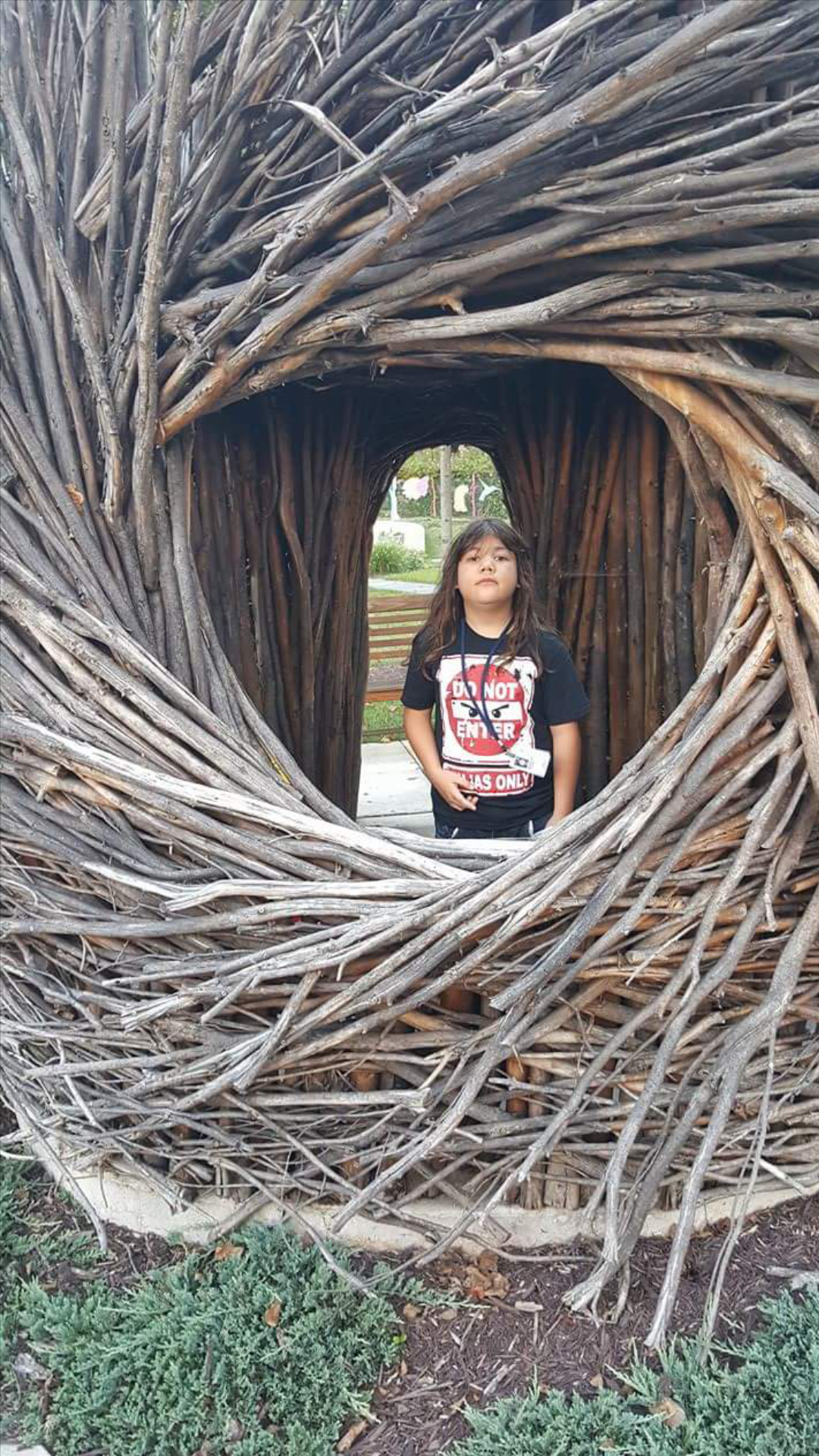 Nicky in a wooden art installation