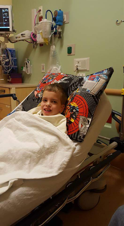 Mitochondrial myopathy child lays in hospital bed