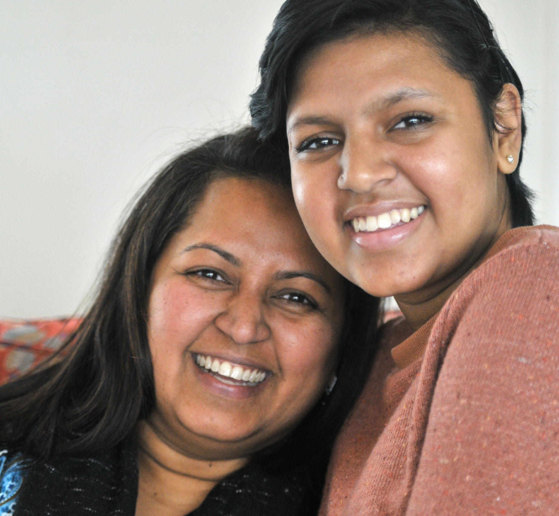Kavya Nadella holding her mother and posing for a photo