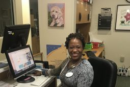 Cathy Troutman at volunteer desk of The Children's Inn