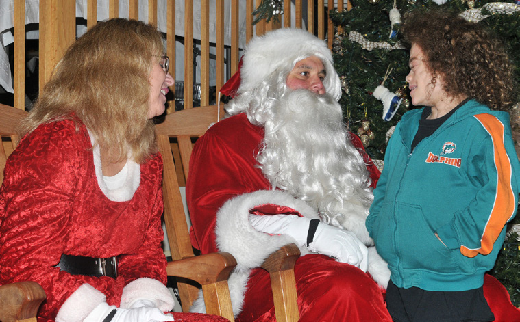 Santa and Mrs. Claus with Inn resident Isaac