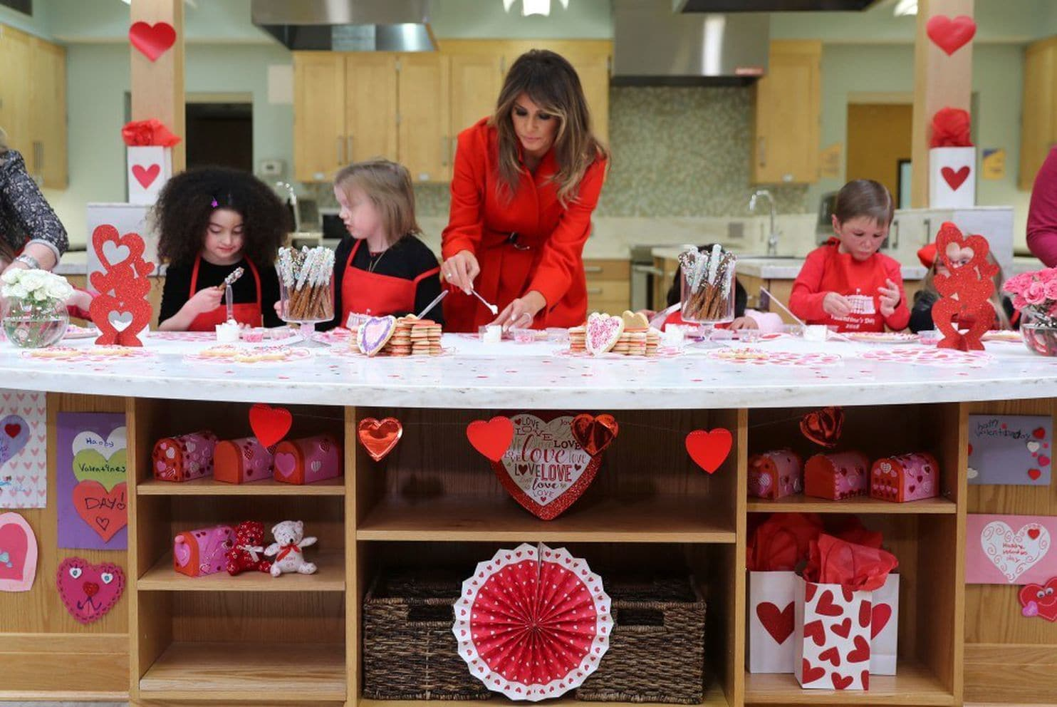 First lady Melania Trump helps decorate cookies during her visit to the Children's Inn on Valentine's Day