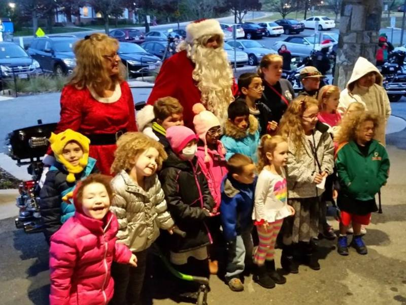 Santa and Mrs. Claus pose with Inn residents