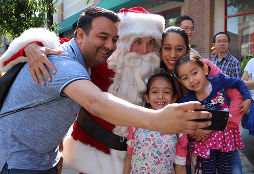 Christmas in July, family posing with Santa