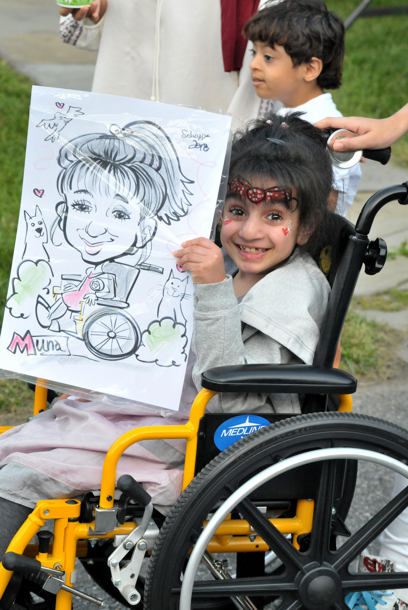 Muna displays her caricature from the carnival event