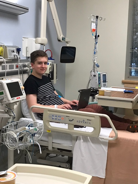 Green family boy getting a transfusion in the hospital
