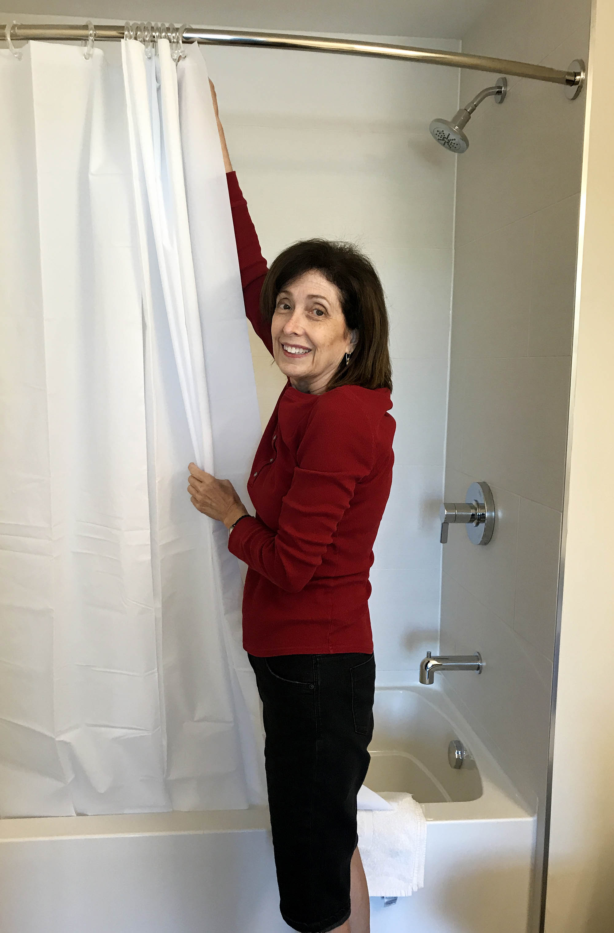 Volunteer setting up a shower curtain