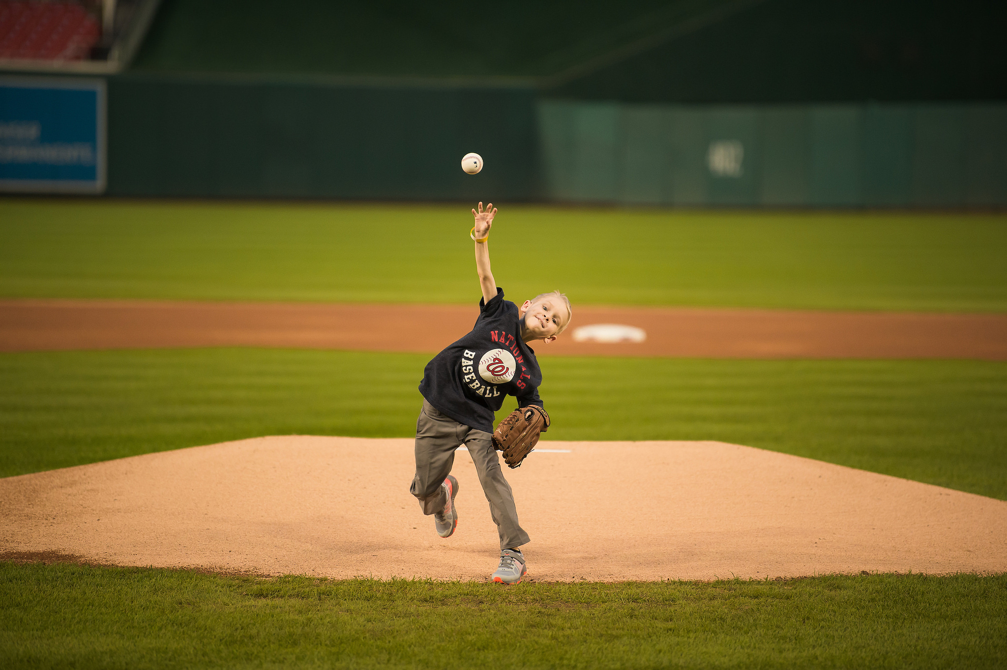 Abram throwing first pitch