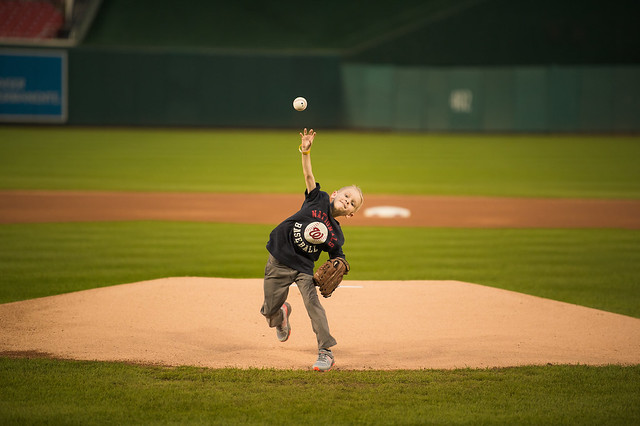 Young boy from The Inn throwing a pitch on the Nationals field