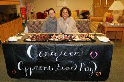 Two women at Caregiver Appreciation desk