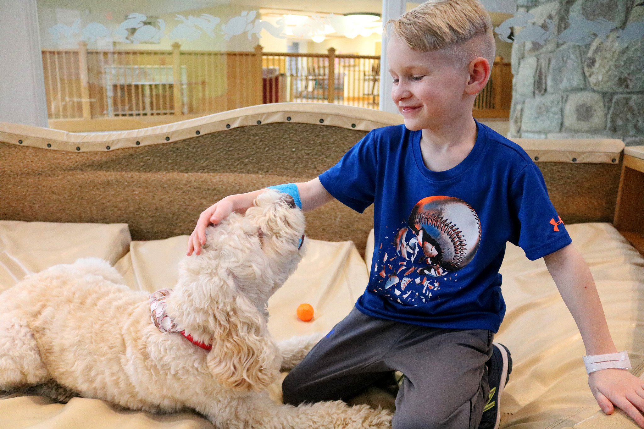 Abram a young boy and Zilly the therapy dog