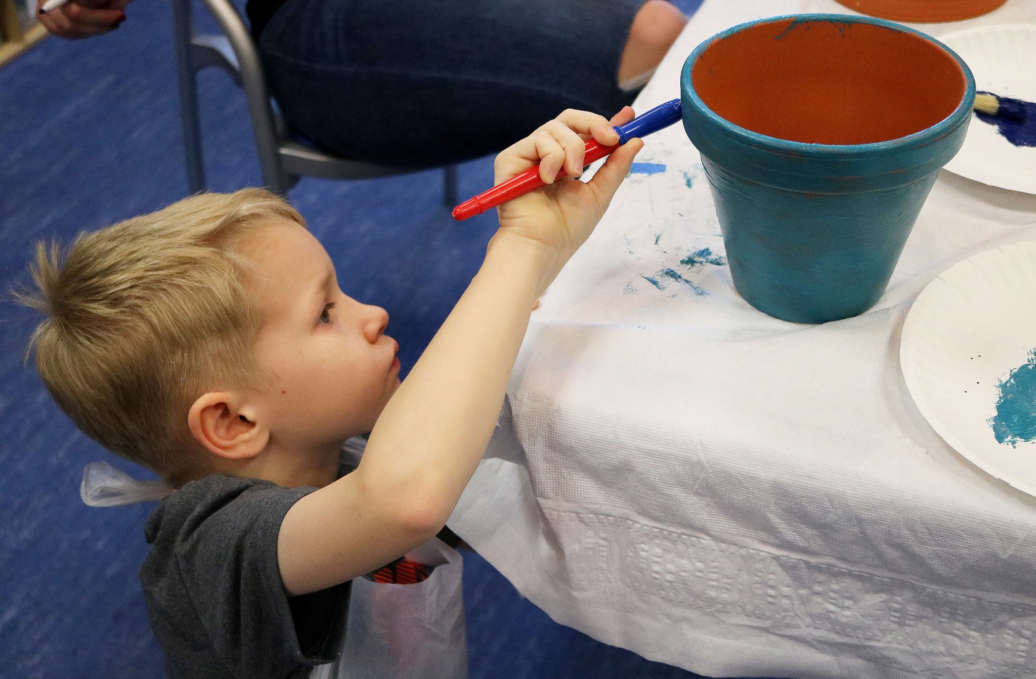 Abram painting a pot