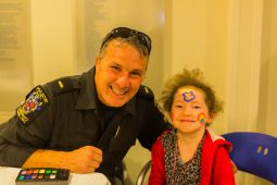 A young girl plays Bingo with Officer Dave