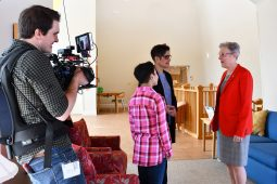 Behind the scenes: Noah, Gisela, and Dr. Tifft are filmed by our crew