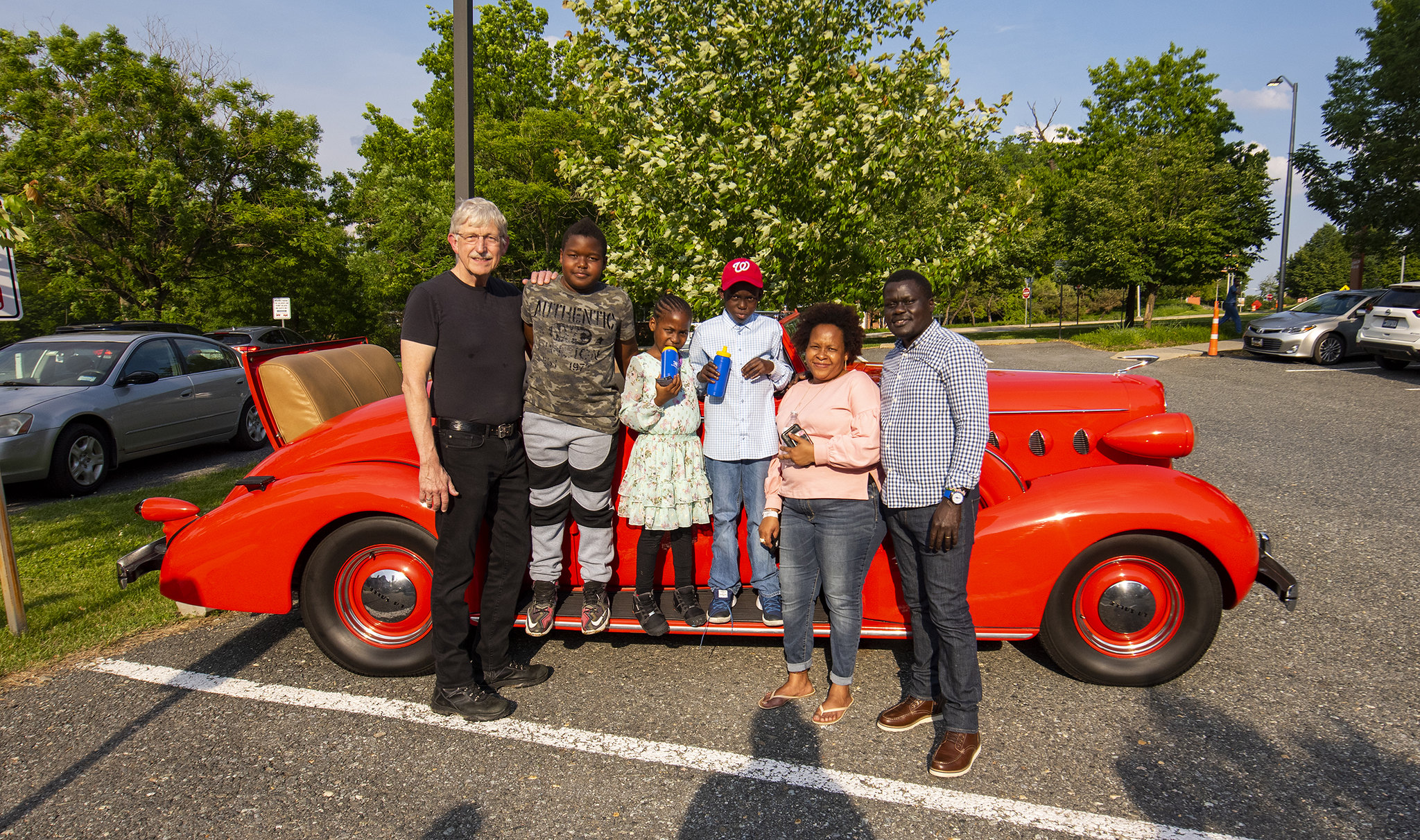 NIH Director Francis Collins, M.D., Ph.D., spends time with NIH pediatric patients staying at The Children's Inn and their families during the second annual car show.