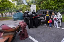 Star Wars vehicles and Batman's batmobile at the car show
