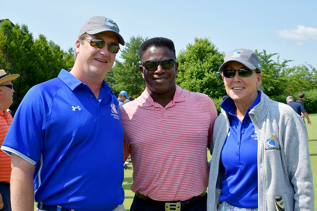 Group of three men at the 2019 Golf tournament