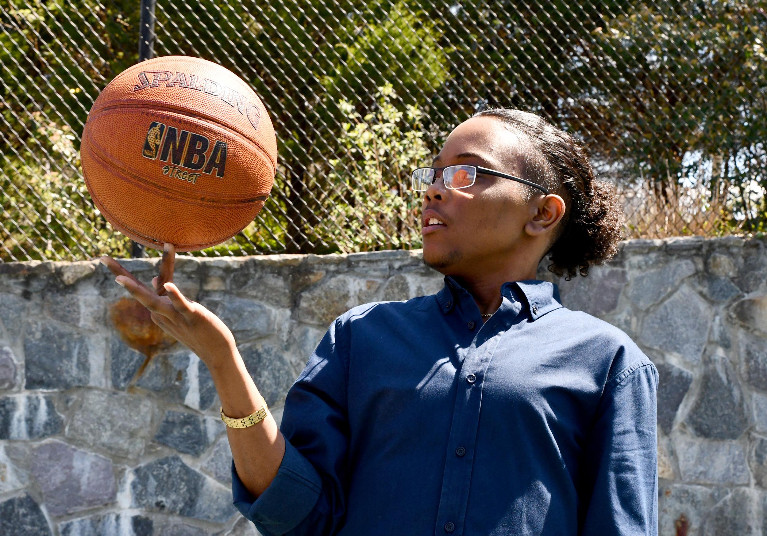 Inn resident Jules plays basketball