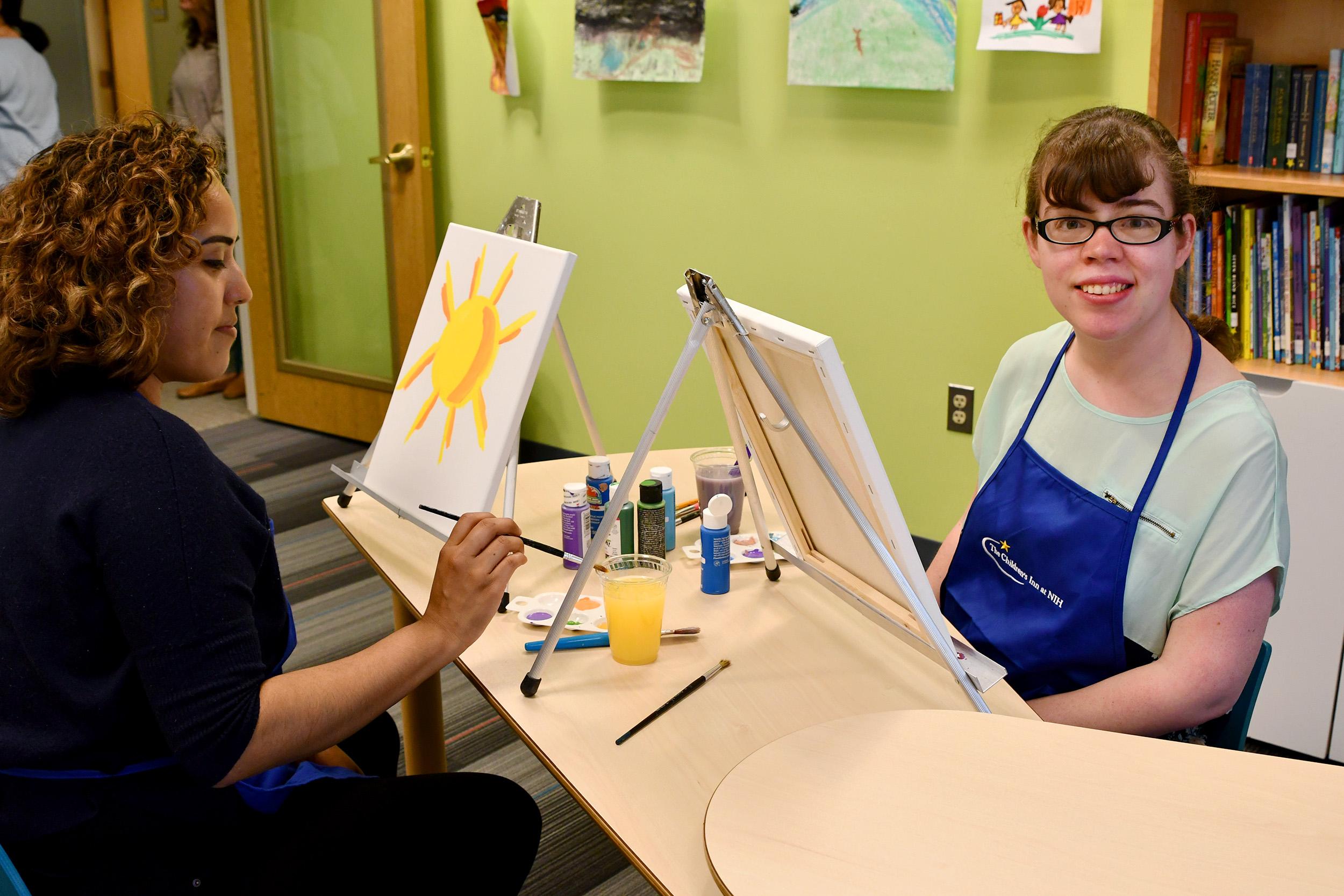 Tina paints with Lidia, an Inn staff member