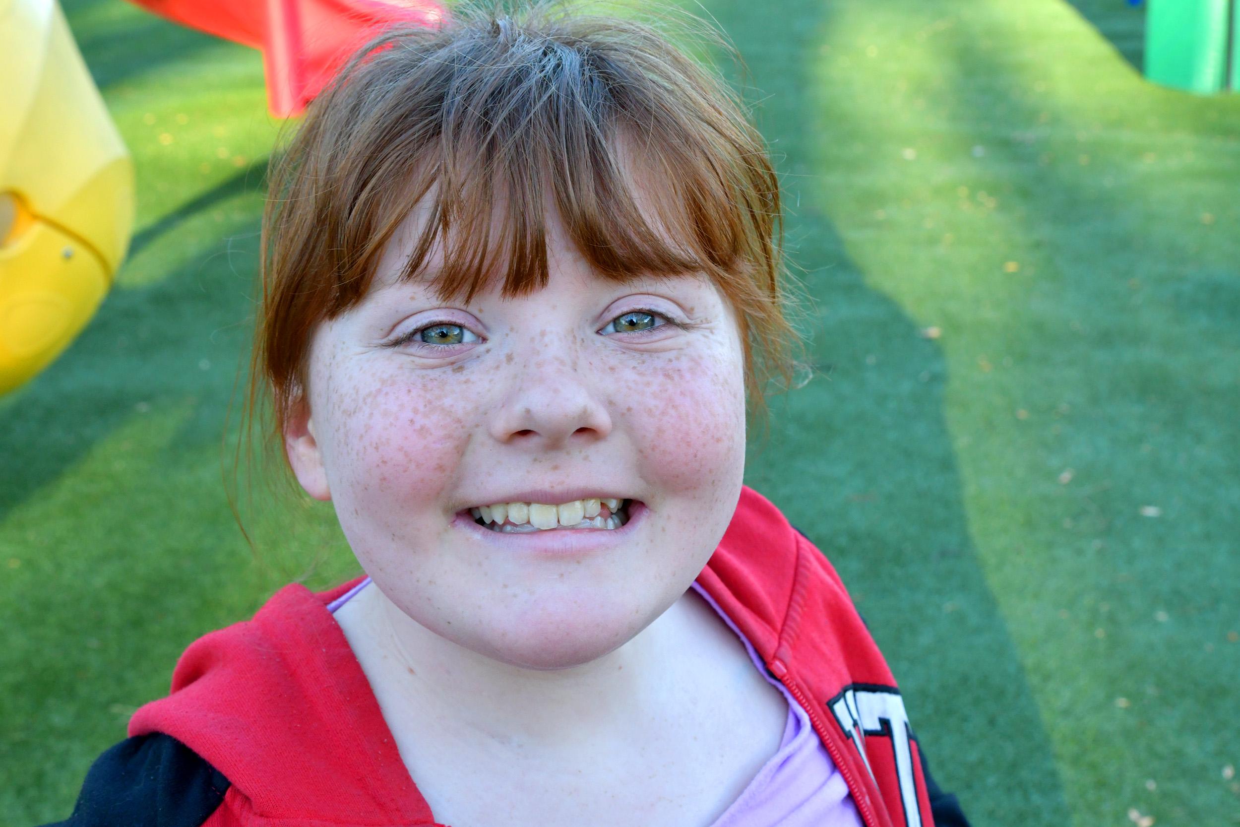 Inn resident Avery, feeling much better now, enjoys the playground