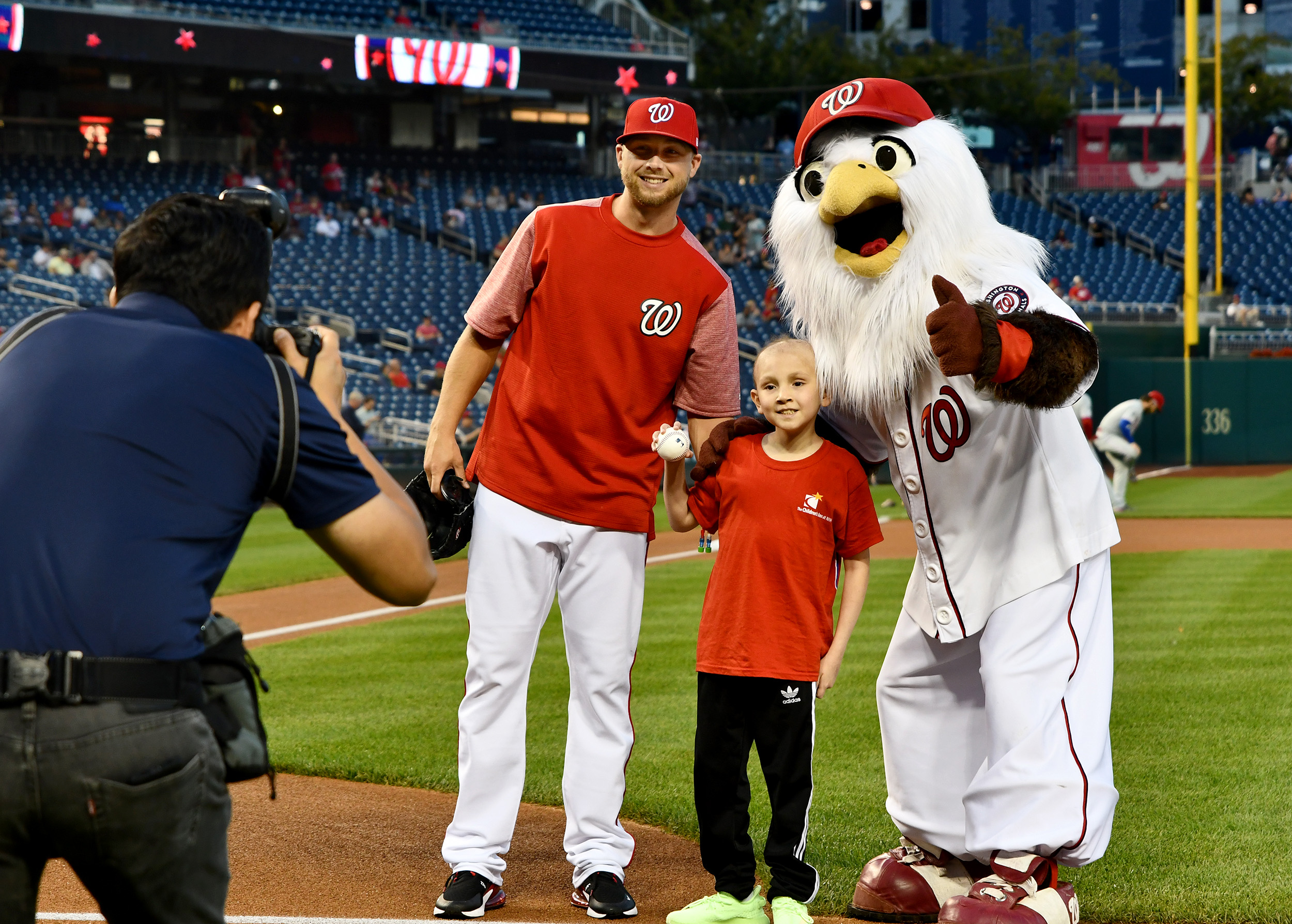 Inn resident Eduardo at Nationals Park with a player and their mascot, Screech