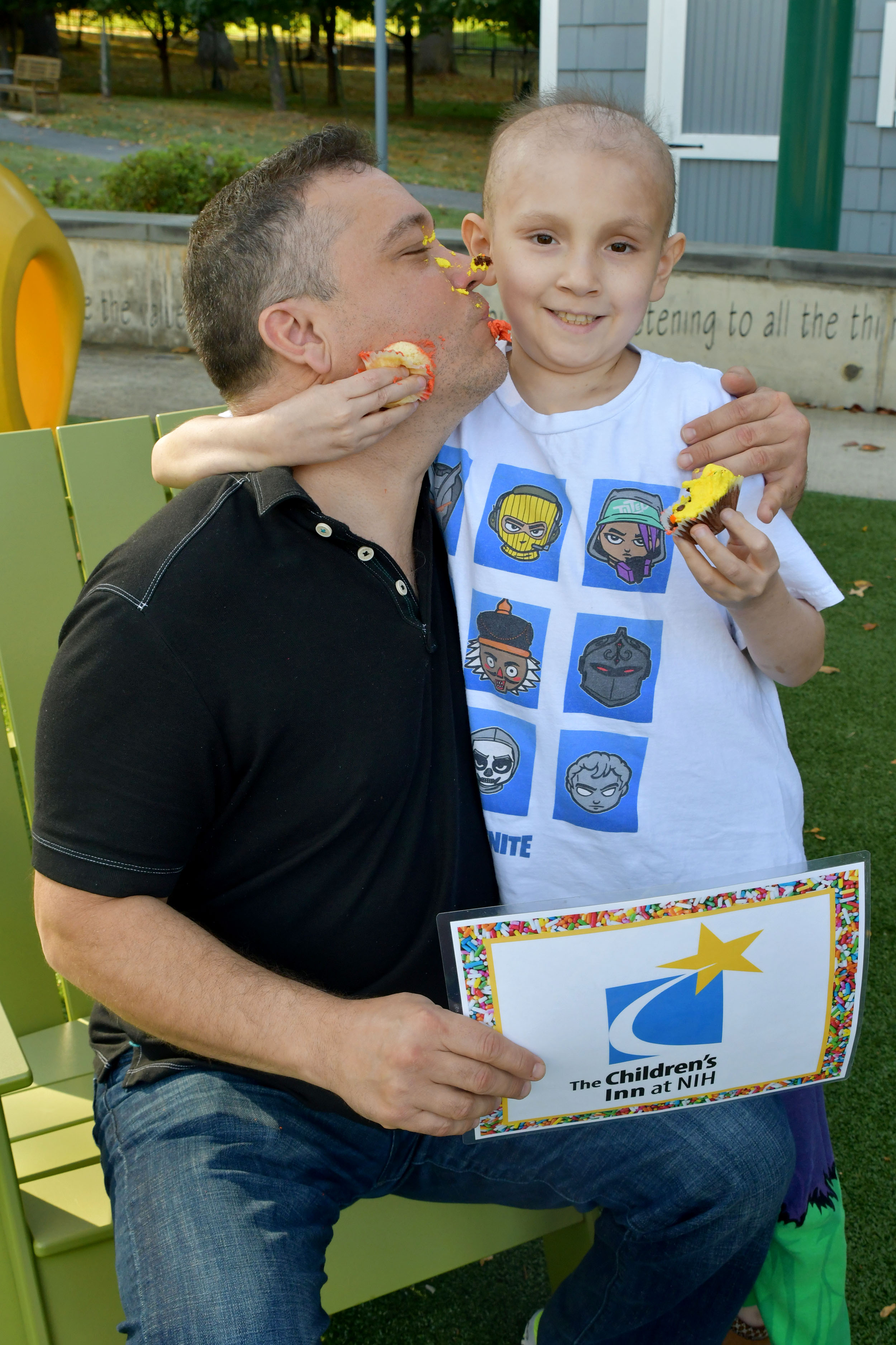 Inn resident Eduardo gets an icing kiss from his dad after caking him