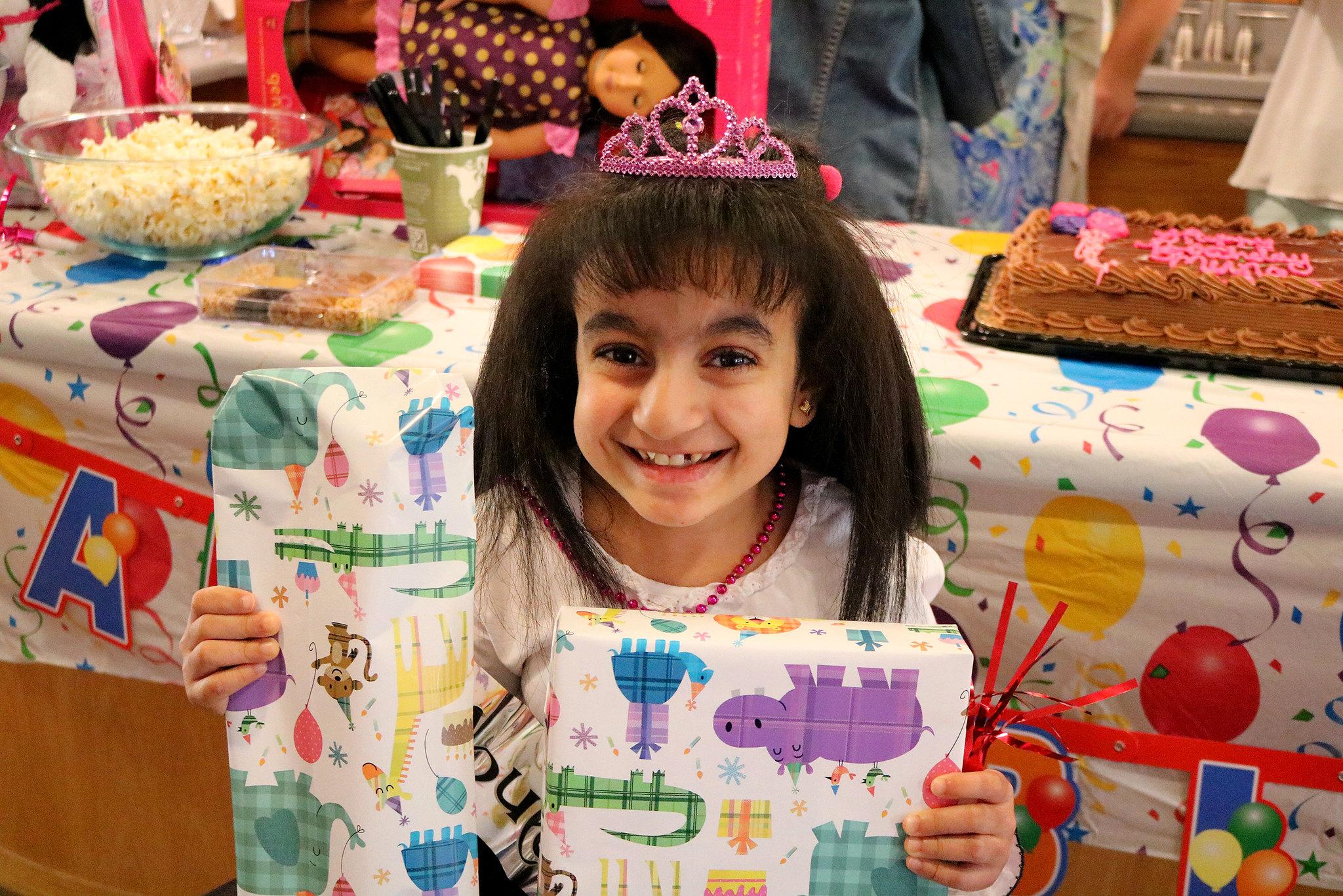 Muna holds up birthday presents