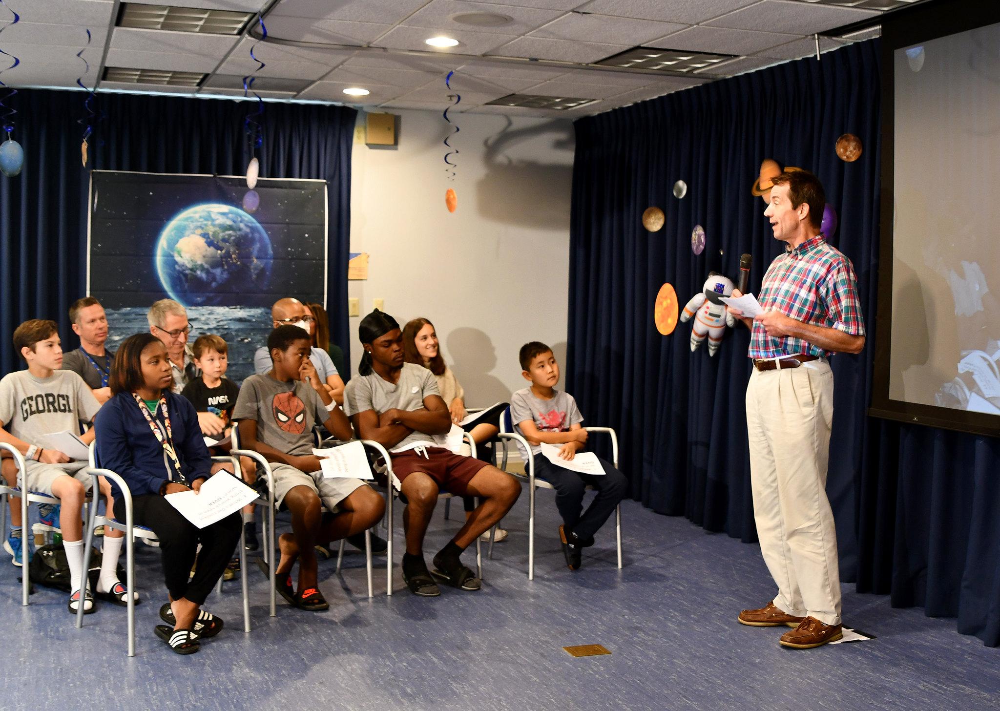 NCATS Director Dr. Chris Austin addresses Inn residents