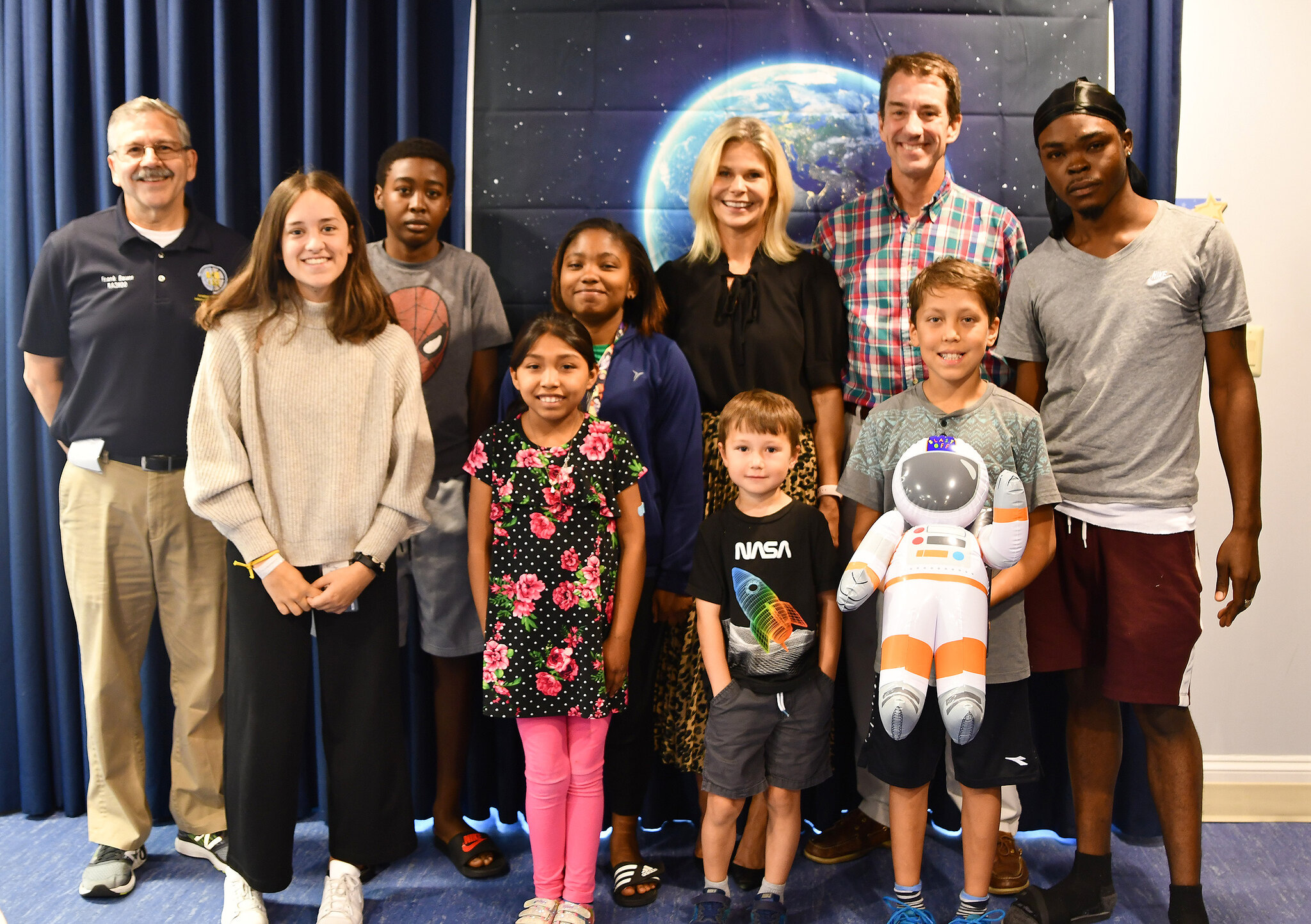 Ask an Astronaut: Biomedical Science Edition - Inn residents pose with Inn CEO Jennie Lucca, NCATS director Chris Austin, and an ARISS representative