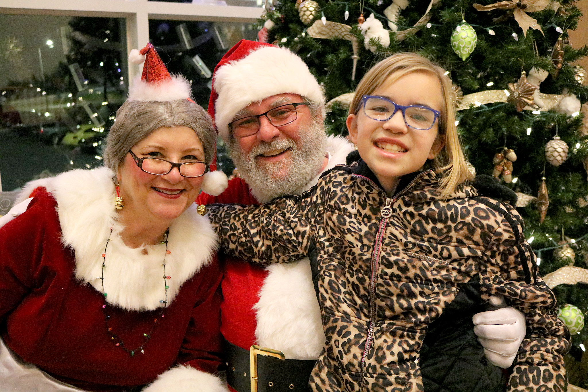 Madison with Santa and Mrs. Claus at the holidays