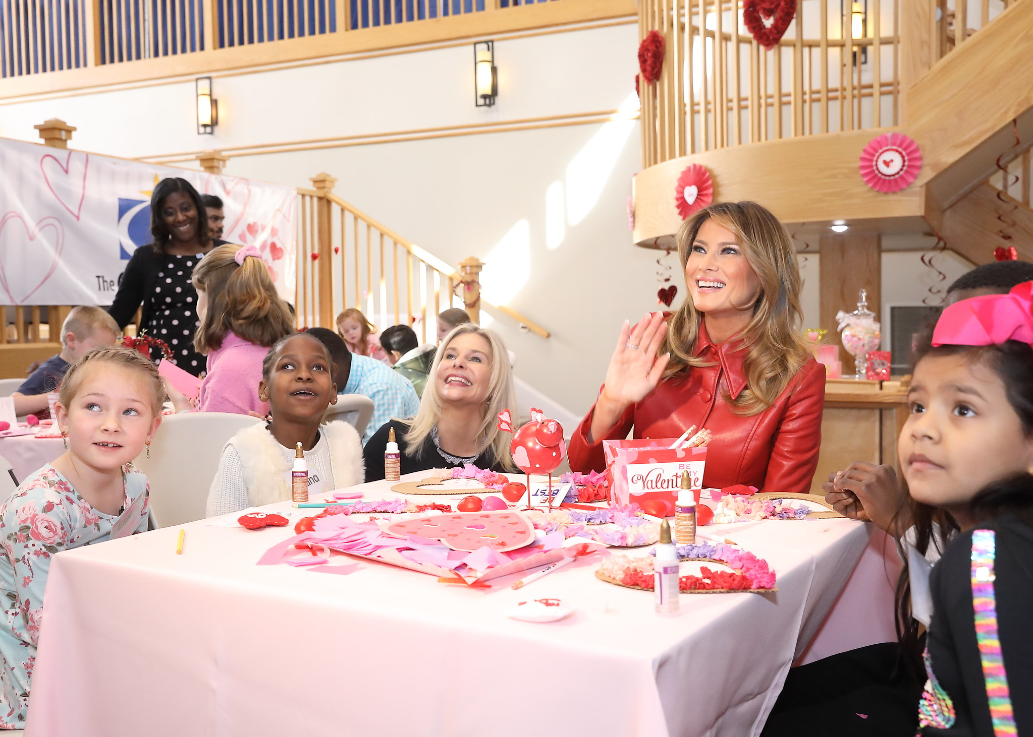 Inn CEO Jennie Lucca and residents with First Lady Melania Trump