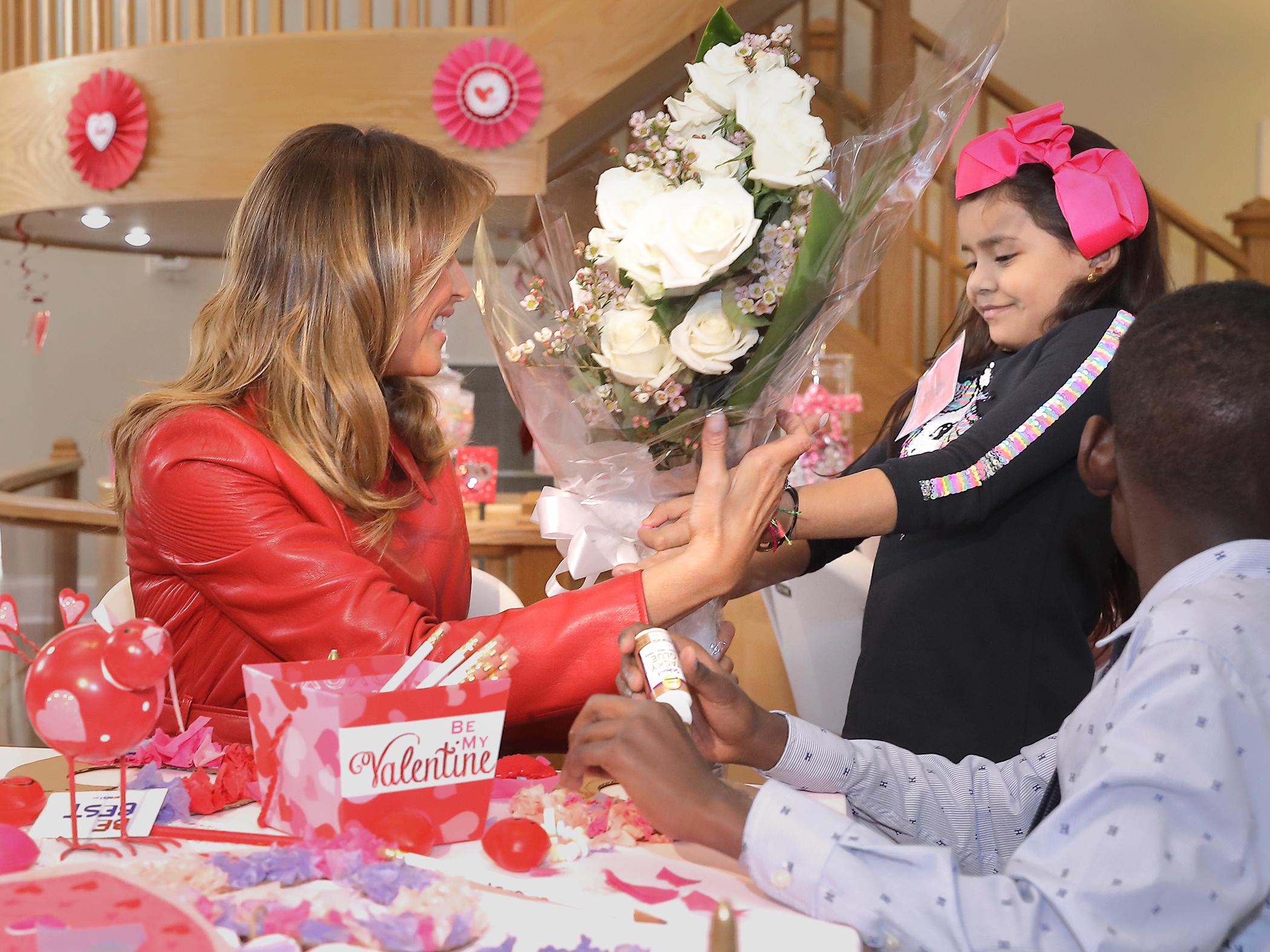 Inn resident Thais presents flowers to First Lady Melania Trump