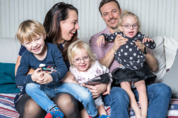Jessica and Niclas hold their children, from left, Hampus, Julia and Isabella prior to undergoing gene therapy
