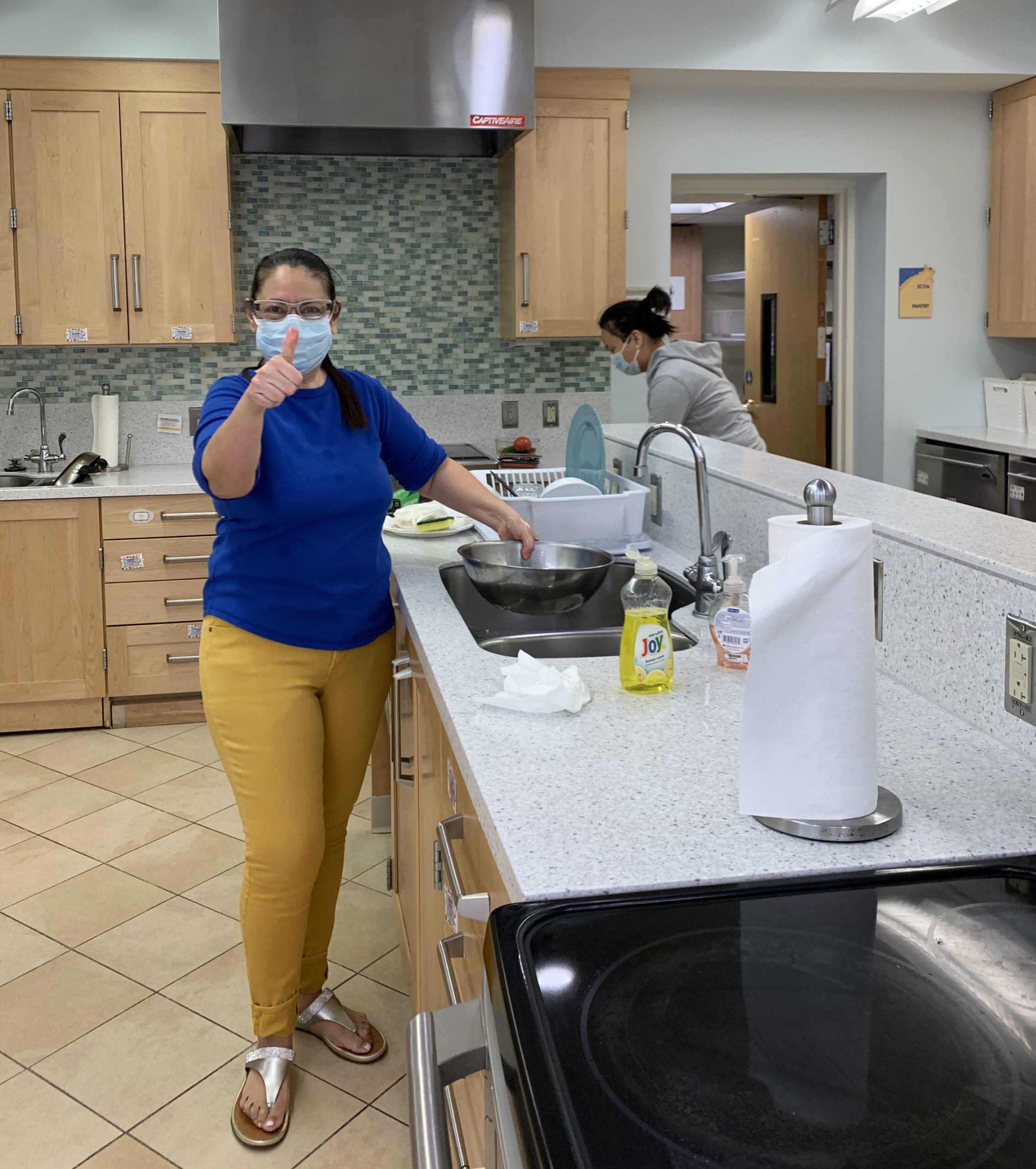 woman wearing a face mask cleaning at the Inn