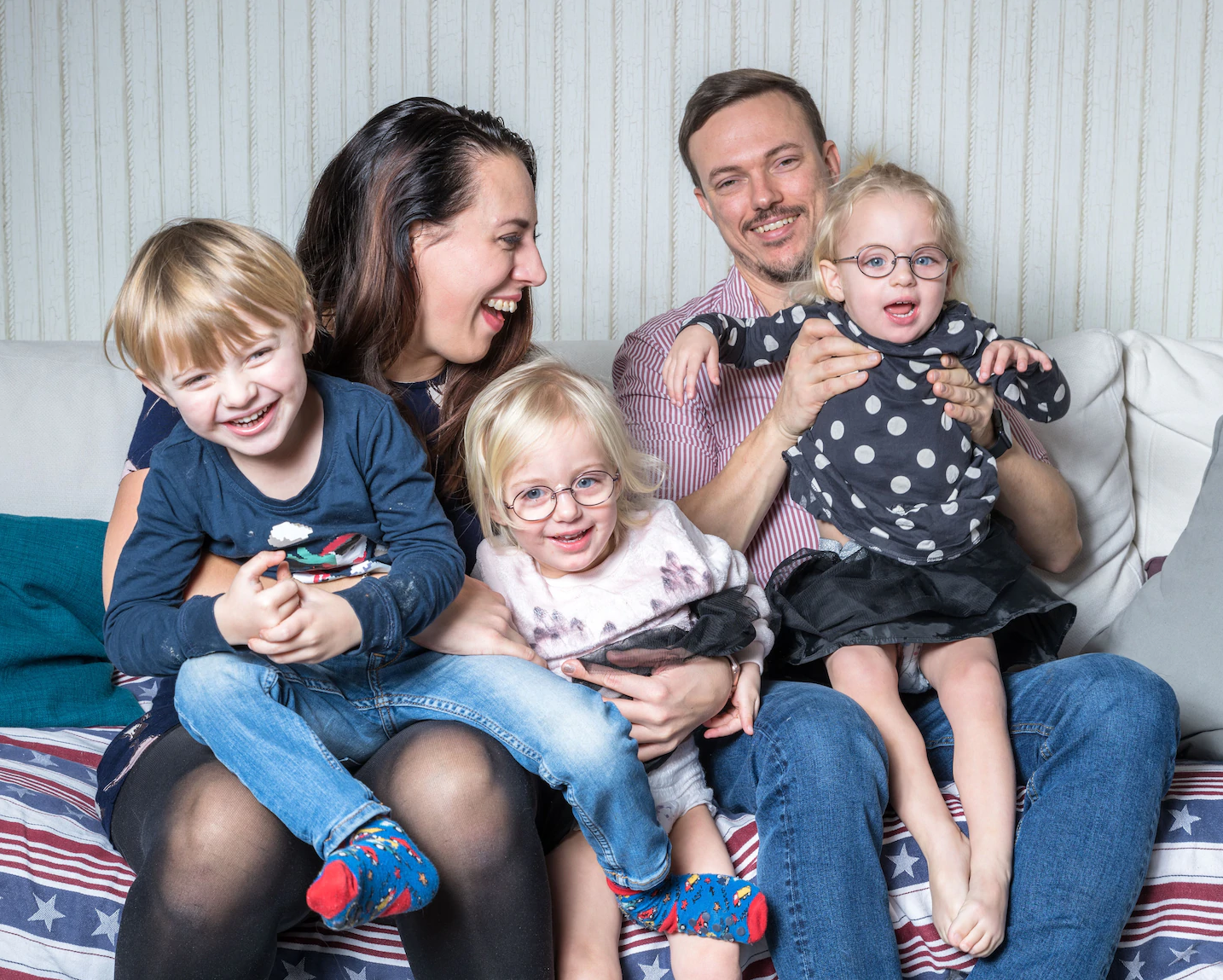 family of five laughing